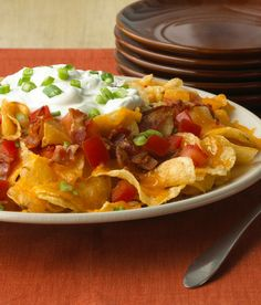 Potachos – We love these potato chips topped with melty cheddar cheese, tomatoes and sour cream. Make this easy appetizer in 15 minutes.
