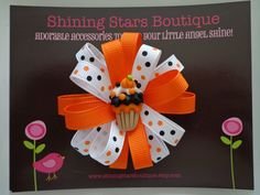 Girls Hair Accessories - Hair Bows - Mini Orange, Black, And White Halloween Cupcake Flower Loop Boutique Loopy Hairbow. $7.99, via Etsy.