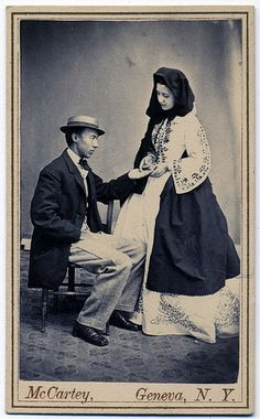 Carte de visite by McCartey of Geneva, N. A palm reader practices her gifts on a gentleman before the camera. This image may not be reproduced by any means without permission. Future Teller, Geneva New York, Old Photos, Vintage Photos, Fallen London, Man Child, Photographs Of People, Daguerreotype, Black White Photos