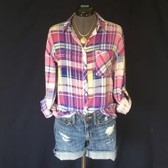 Olive & Oak Pretty Plaid Blouse So Pretty!  Beautiful spring colors of various shades of pink, blue & yellow. This is a loose fitting blouse, no bust darts. Long sleeves with button roll tabs, single button cuffs, button up front, collar, shirttail hem, & back yoke. Size Small. Bust measured flat is 19 inches, back of neck to hem is 28 inches. 100% rayon so it feels silky smooth and cool and drapes beautifully. In Perfect Condition. Olive & Oak Tops Button Down Shirts