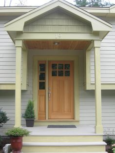 This Raised Ranch Entry (featured in Better Homes Magazine) was transformed with a portico and updated door. Raised ranch reno