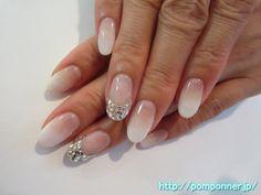 ストーン埋め尽くしフレンチがゴージャスなネイル  French nail is gorgeous fill Stone. Make a French White to clear base, ring finger ran out of stone filled with crystal. Nail the other made a color gradient in white.