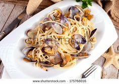 Plate of spaghetti with clams, typical recipe of the Mediterranean cuisine. by eZeePics Studio, via Shutterstock