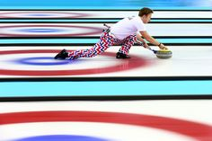 Torger Nergaard of Norway releases the stone during the Curling Men's Round Robin match between Great Britain and Norway on day 9 of the Sochi 2014 Winter Olympics at Ice Cube Curling Center on February 16, 2014 in Sochi, Russia. (Photo by Paul Gilham/Getty Images)