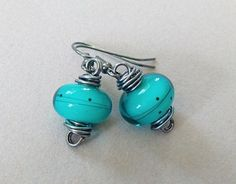 Teal glass bead and gunmetal  wire wrapped earrings £14.00