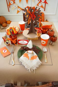 Thanksgiving Kids' Table.  Brown craft paper.  Rectangles drawn for placemats for kids to color placemats themselves.  Votive of crayons & little matchbook-style pack of papers to draw on banded with a napkin ring.  Turkey finger puppet.  Tree of Thanks for Centerpiece.  Kids write what they are thankful for on leaves & hang from tree.  Kid-size pies with 5-inch pie pans.