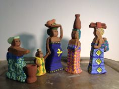 """First four figures under-glazed and drying. They're the """"entourage"""" of womenfolk who show up in West African créches: one woman to piler the foutou, one to carry water, one with wood for the fire, and one with food on her head. I added an obviously pregnant momma with her toddler holding her hand.   FUN set. Cannot wait to finish.  Set by Tammy Gentuso www.gentusophotography.com"""