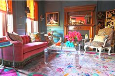 Summer Thornton | rug + pink couch + lucite coffee table + leopard (Chair from Revision Home Chicago)