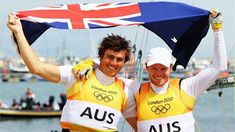 Australia celebrate winning gold in the Men's 49er  Nathan Outteridge (R) and Iain Jensen (L) of Australia celebrate winning gold in the Men's 49er Sailing on Day 12 of the London 2012 Olympic Games.