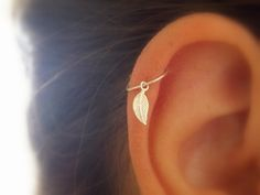 My daughter will love this. sterling silver hoop with tiny silver leaf charm. size : *22 gauge. *Diameter: 8 mm.