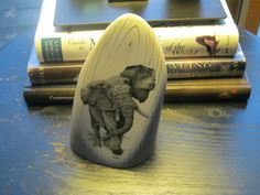 """This is the tip of a very large and old elephant tusk.  The scrimshaw was done by Darrel Morris and is titled """" Defiant """""""