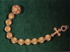Henry VIII's rosary. This rosary owned by Henry VIII, consists of a ring from which hangs a cross, ten Ave beads, and a large bead for Pater Noster. It has been richly carved throughout and the Pater bead is hinged, with two biblical scenes carved inside.