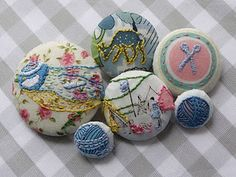 Embroidered and fabric covered buttons.