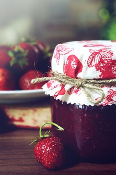 """Les confitures de fraises"" (strawberry jam), topped with a pretty fabric ""lid"""