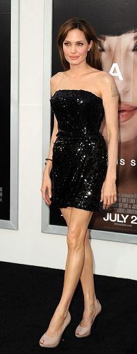 Who made Angelina Jolie's black strapless dress, nude pumps and jewelry that she wore the premiere of her new spy thriller, SALT, at LA's Grauman's Chinese Theatre on July 19, 2010? Dress – Emporio Armani  Shoes – Ferragamo  Jewelry – Asprey