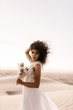Desert Sand Dune Wedding Inspiration with Natural Hair Ideas for Black Brides – Tor Hawley – The LAW Bridal 48 Go natural on your wedding day! Here's the inspiration you need! #bridalmusings #bmloves #wedding #weddinginspo #weddinginpiration #naturalhair #natural #curls #curly #naturalcurls #weddingdress #bridalgown #inspiration