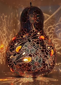 Dragonfly gourd lamp by Adele Bishop. Love the crazy pattern the cutouts & amber glass casts on the wall.