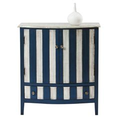 Showcasing 2 doors and a blue and white stripe motif, this charming cabinet adds a lovely touch to your entryway or master suite.   Prod...