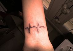 Life Symbol    Carved at a strategic point, this simple heartbeat tattoo, stands for the simple but precious movement that runs our life.