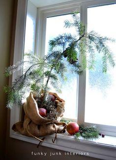 Make a burlap sacked Charlie Brown Christmas tree - FunkyJunkInteriors.net