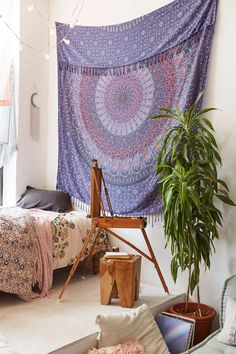 Maina Medallion Tapestry - Perfect to accent a wall, top off a couch, or take with you to the beach. 100% festival-friendly, too! (aff link)