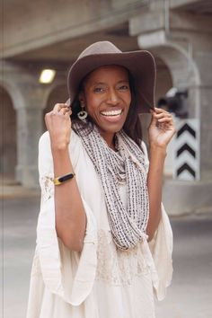 Two of our favorite fashionable accessories: The Mira wellness bracelet and a great hat.