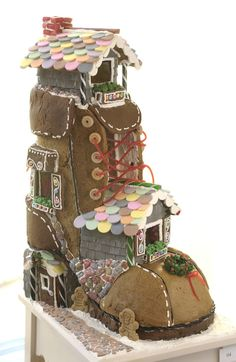There was an old lady who lived in a gingerbread shoe. this is completely made from gingerbread and candy! Christmas Gingerbread House, Gingerbread Man, Christmas Treats, Gingerbread Cookies, Christmas Cookies, Christmas Decor, Beautiful Cakes, Amazing Cakes, Winter Torte