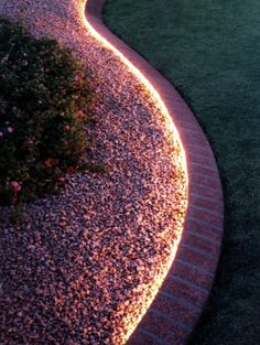 Rope lighting around the garden. Inexpensive, waterproof and you can use a timer.