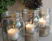 Mason jar candles with sand and glass votives from The Rustic Raven at Etsy.com.