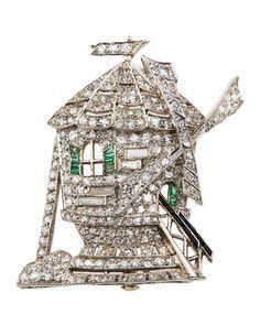 Platinum windmill pin. White diamonds, 3.50 total carat weight. 12 emeralds and inlaid black onyx.