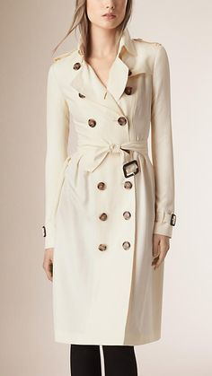 Burberry Parchment Skirted Silk Trench Coat - A double breasted trench coat in lightweight silk. The fitted design features a belted waist and a full gathered and pleated feminine skirt.