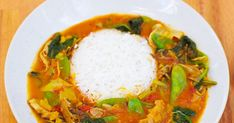 A fragrant tomato and coconut vegan curry with banana blossom and greens Recipes With Banana Peppers, Stuffed Banana Peppers, Tomato Curry, Spinach Curry, Banana Blossom, Cooking Basmati Rice, Tinned Tomatoes, Vegan Curry