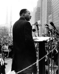 "Rev. Dr. Martin Luther King Jr., leads a crowd of 125,000 Vietnam War protesters in front of the United Nations in New York on April 15, 1967, as he voices a repeated demand to ""Stop the bombing."" (AP Photo"
