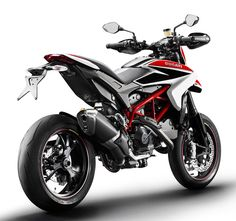 Ducati's Hypermotard credibly captures the athletic character and hooligan attitude of a true supermotard without any of the conventional compromises. Read all about the 2013 Ducati Hypermotard, here. Ducati Motorcycles, Cars And Motorcycles, Motocicleta Ducati Hypermotard, Motard Bikes, Pit Bike, Motorcycle Bike, Super Bikes, Street Bikes, Bike Life
