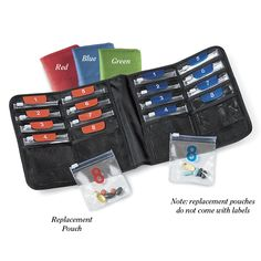 """Magellan's Day/Night Pill Organizer - Carry your medications in handy day and night dosages. Compact and lightweight organizer has 16 individually labeled, removable pouches, color-coded for daytime and nighttime use, with slide-locks to keep pills secure. Hook-and-loop closure. Zip pocket on the back to store prescriptions. Colors: Black, Red, Blue or Green. 7 ¾"""" x 4"""". Folds flat"""