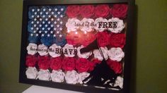 Great piece to decorate your home and show your patriotism!  This is a 14x18 Shadow box with hand rolled paper flowers and a high quality vinyl on