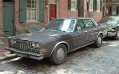 1986 Plymouth Caravelle (3rd Gen) 4-Door Sedan 3.7L Slant-Six or 5.2L V8 engines