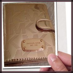 """Authentic Michael Kors Logo Card Holder Wallet Gold tone folding card holder, passport case with snap closure. Logo plaque MK signature on front, pockets and 4 slots inside. Measures 4"""" x 5-1/2 closed. This is fabulous gift for Valentines Day.  Trades. Price  firm unless bundled.❗️ Michael Kors Bags Wallets"""