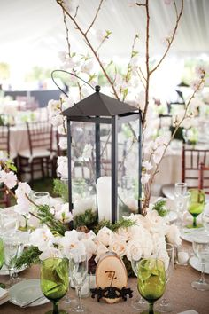 Southern centerpiece idea: wrought iron lantern with cherry blossoms Photo: Captured Photography