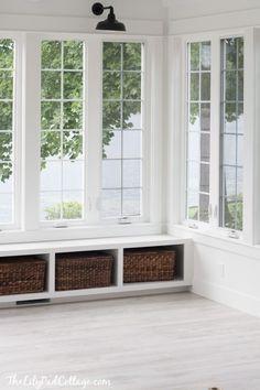 White Sunroom decor ideas.  The rustic-looking white floor is laminate!