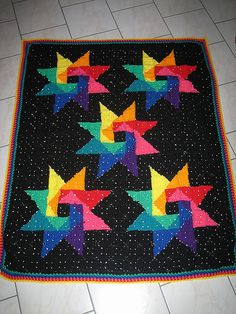 Inspiration :: Colorful pinwheels afghan, using bicolor granny squares . . . . ღTrish W ~ http://www.pinterest.com/trishw/ . . . . #crochet #blanket #throw #granny_square #star