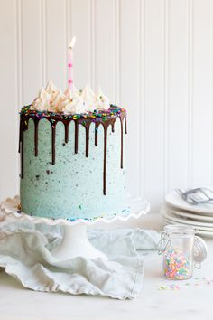 Birthday Oreo Cake with confetti cake, chocolate cake, and oreo frosting.