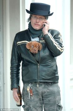 And they call it puppy love: Former pop star Adam Ant - real name Stuart Goddard - keeps his cute little pup warm during a stroll round London  --------------------------------------------  I've seen more recent pictures of his with this dog (Billy), who is now HUGE.