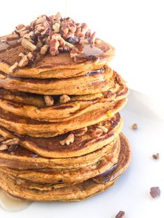 The fluffiest pancake recipe you'll ever make, these whole grain pumpkin pancakes are spiced with cinnamon, nutmeg and ground ginger.