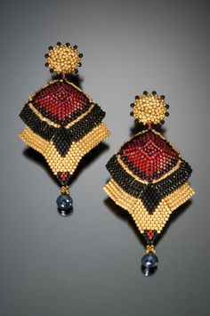 Inspired by the art deco movement. Glass seed beads with 24kt gold plate. Made with a variety of beadweaving stitches.