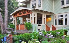 Remodeled American Foursquare by Degnan Design.  The new landscaping around the house adds even more to its appeal. So pretty!  -  Pinned 9-11-2015.