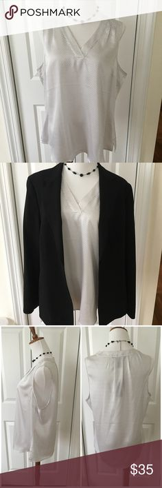 Banana Republic sleeveless dress shirt. This sleeveless white dress shirt with black polka dots  goes nicely under a suit jacket or go for the summer look and pair it with a skirt and tank/slip underneath. Size 14. Never worn/new with tags. Banana Republic Tops Blouses