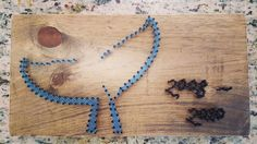 String Art- whale tail, blue, stained wood, nails, wall art, dates Made By: Jennifer Macleod Schutt