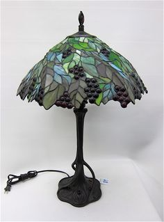 A STAINED AND LEADED GLASS TABLE LAMP