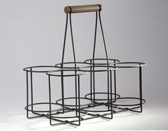 French wire bottle carrier  ~could use for wine bottles or place mason jars and fill with flowers for a centerpiece...